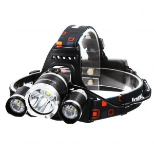 Image of a headlamp with three bulbs, in multi-colored headlamp holder
