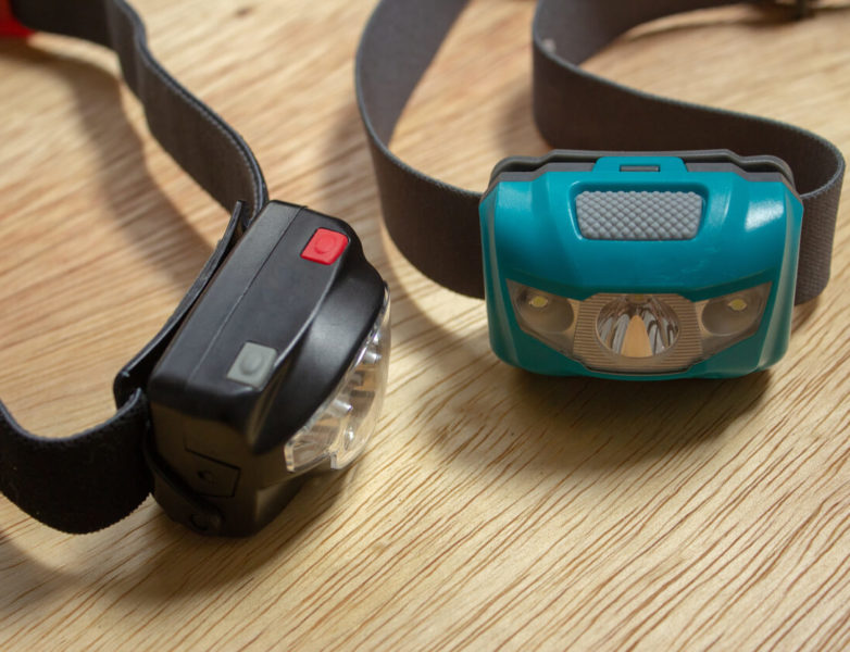This is an image of two headlamps in black and turquoise color.