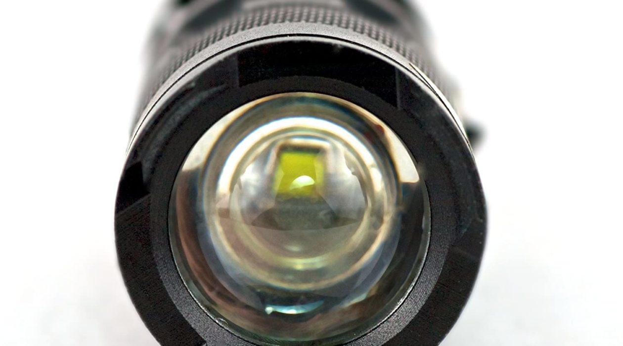 Image of a zoomed flashlight lens facing forward.