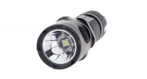 Image of a flashlight with zoomed lens facing forward.