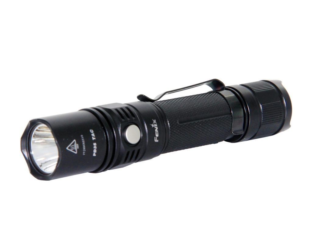 This is an imageof a small black flashlight with metal clasp pin