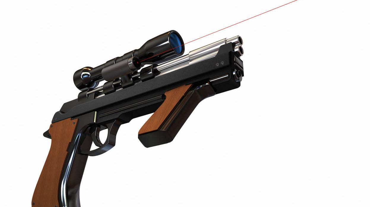 This is an image of a pistol gun with red laser light attached on top of it.