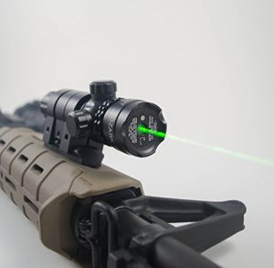 This is an image of Ozark Armament Laser Sight attached to a rifle, with green laser beam.