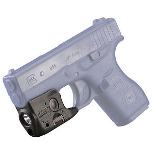 Image of a black Streamlight TLR-6 Tactical Pistol Light attached to a pistol.