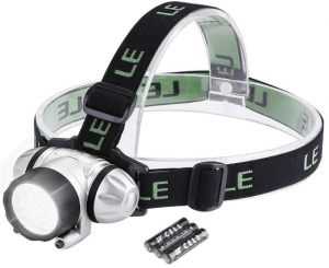 Image of a headlamp in black and white color, with head light on. Includes a 3-AAA batteries beside it.