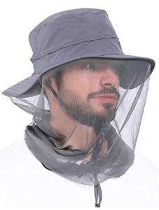 This is an image of a man wearing a mosquito cap with net covering his neck and face.
