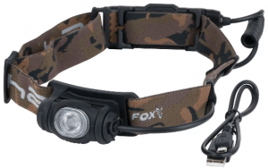 Photo of a headlamp in brown color with attached black colored lamp case, and a USB cord beside it.