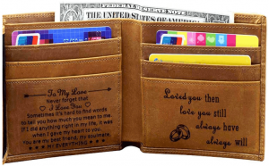 A photo of engraved brown wallet with accessories inside