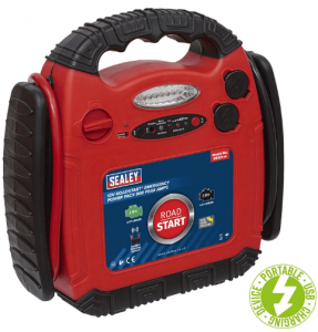 A photo of a jump starter in red and black color, with LED on front and a knob on one side for power.