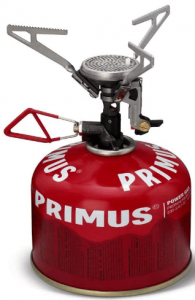 Image of a red camping stove tank with tripod cooktop.