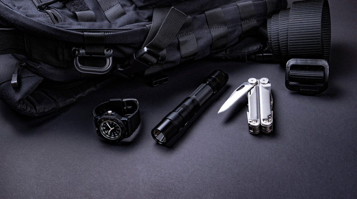 Photo of a black tactical gear and led flashlight.