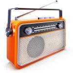 A photo of a portable orange radio with antenna slightly raised.