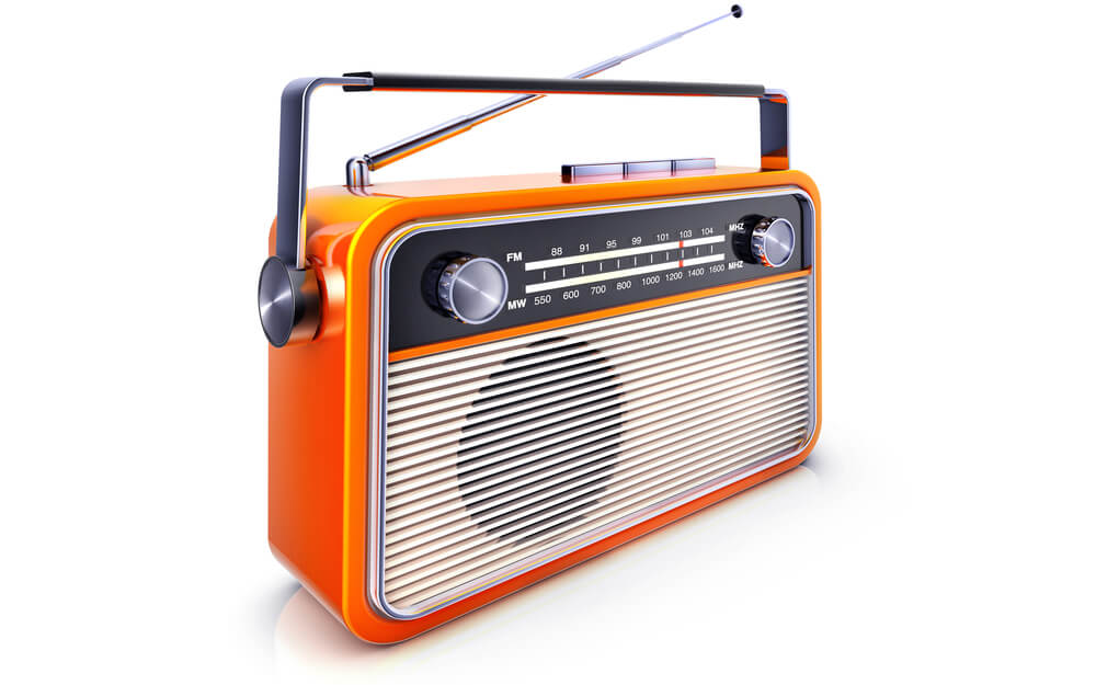 A photo of a portable orange radio with antenna slightly raised.