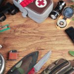 Survival kit with various gear for outdoor survival