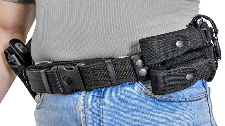 man wearing a survival belt