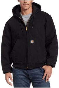 Image of a man wearing a Carhartt Men's Quilted Flannel Lined Duck Active Jacket, in color black. Zipper-up closure type.