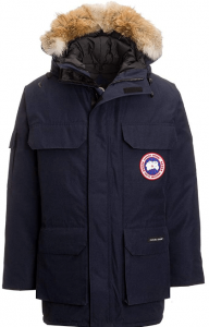 This is the image of a Canada Goose Men's Expedition Parka Coat with four pockets on front and a fur on the hood.