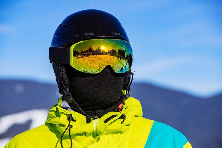 portrait of man in snowboard mask helmet and balaclava.