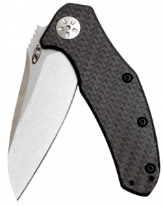 Image of a folded Zero Tolerance knife, steel lade, carbon fiber black-colored handle.