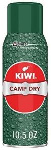 Image of a Kiwi Camp Dry Heavy Duty Water Repellent in green can with red-colored print on it.
