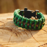 survival Bracelet on a tree trunk in autumn forest, no people