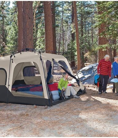 Photo of family having an outdoor camping