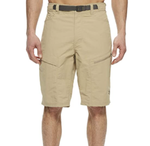 Image of an unknown man standingin half body image only, focusing on the coffee-colored shorts he is wearing, with two side pockets in zipper closure seen.