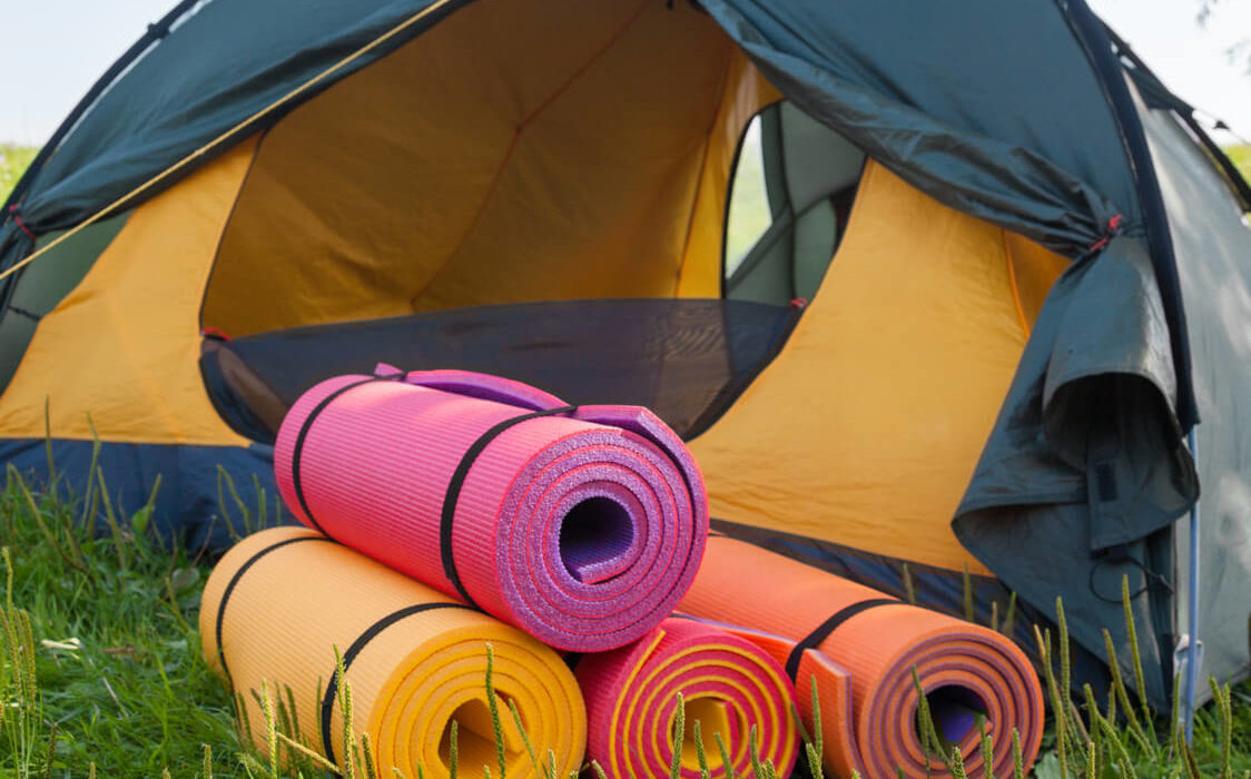 Photo of tent and colored sleeping pads