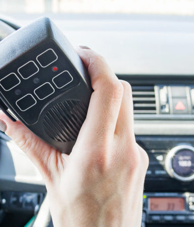 Photo of hand holding a cb radio on a truck