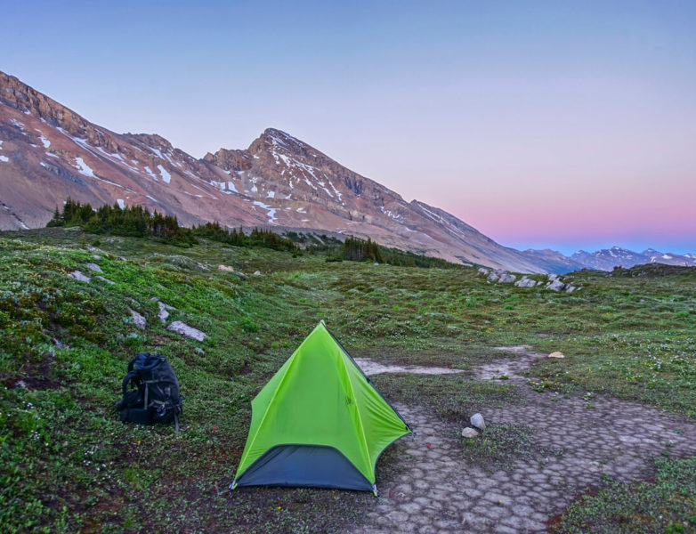 Photo of a tent pitched on the mountain