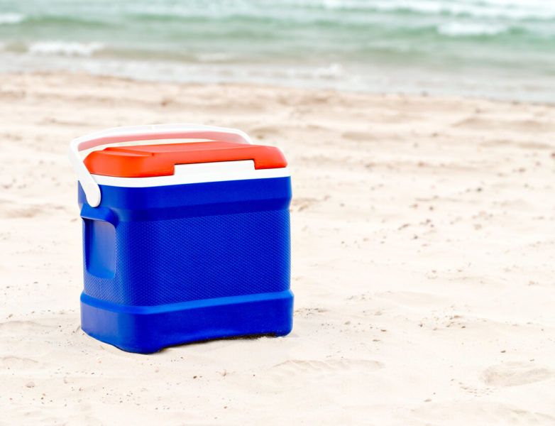 Photo of a cooler on the sand at the beach