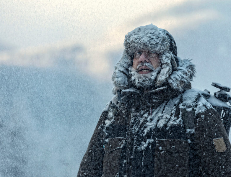 Image of a man with fury in snowstorm