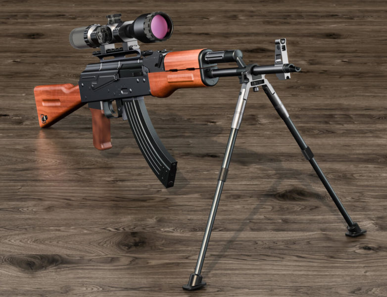 This is an image of a rifle with bipod on a wooden table.