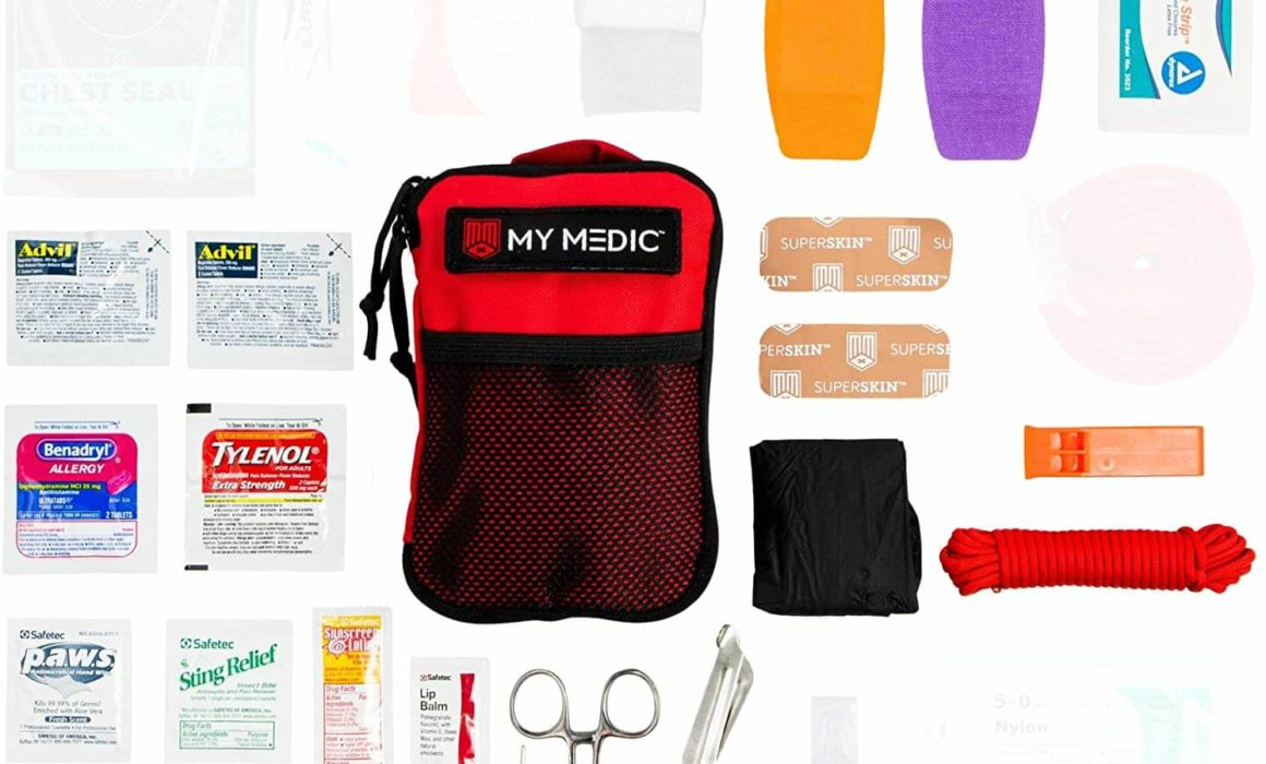 This is a photo of the MyMedic first-aid kit laid around the kit bag at the center,on a white background.