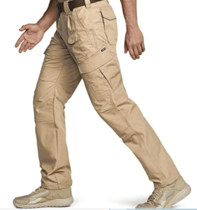 Image of a man wearing a coyote-colored tactical pants with side-pockets.