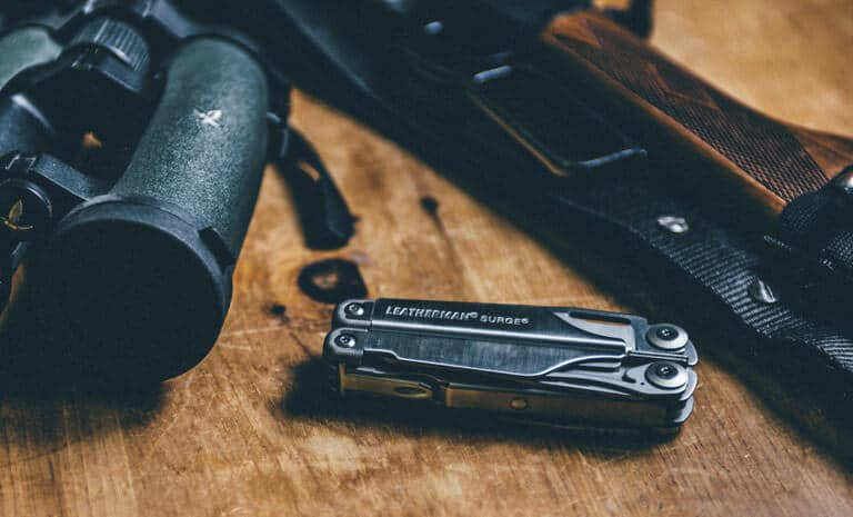 A close-up image of the Leatherman Surge 21-in-1 Multi-tool laid on a table top.