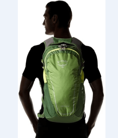 Image of a man wearing the Osprey Daylite backpack, green color, on a white background.