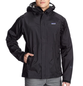 This is an image of a man wearing the Patagonia Torrentshell Jacket with one hand in the side pocket, black color.
